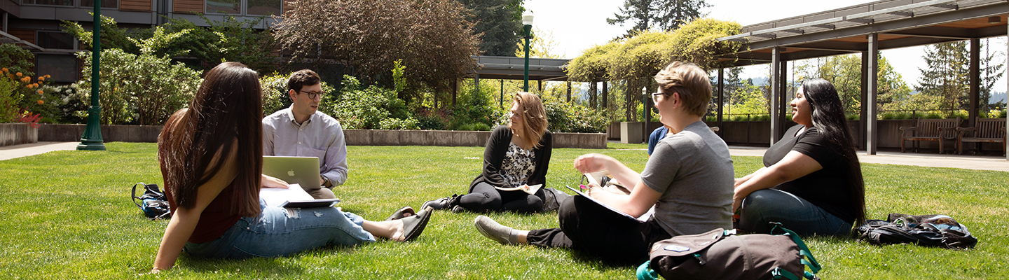 University of Oregon College of Education students sitting in HEDCO courtyard outside