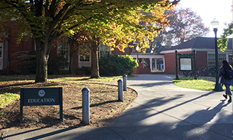 student walking to the UO College of Education building