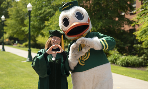 University of Oregon College of Education Graduate with the Oregon Duck