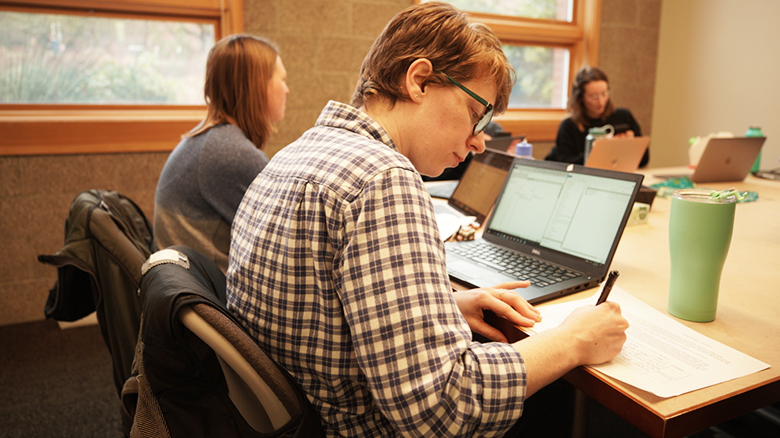 University of Oregon College of Education student at table in study group